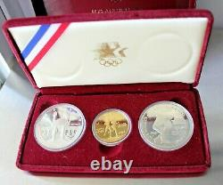 1983-1984 Olympic 3 Coin Uncirculated Set, (2) Silver Dollar & (1) Gold $10 coin